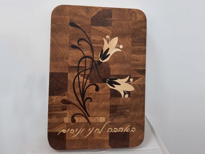 אומנות בקרשי חיתוך מעץ